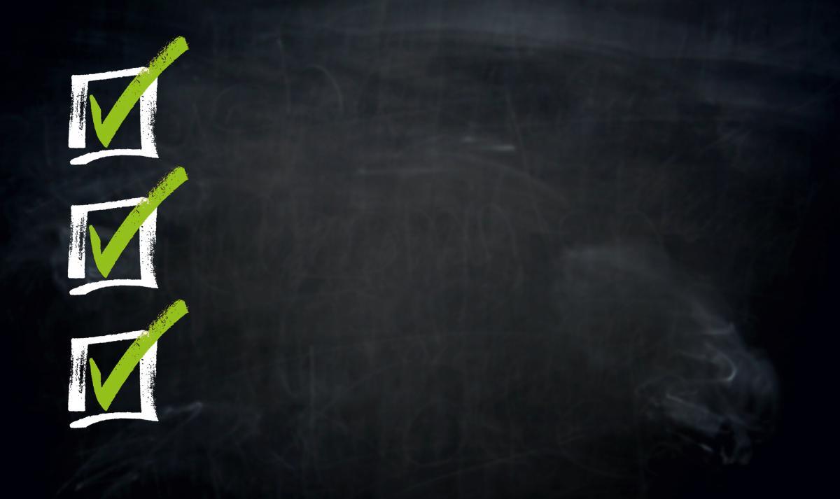 black chalkboard with checklist drawn in white