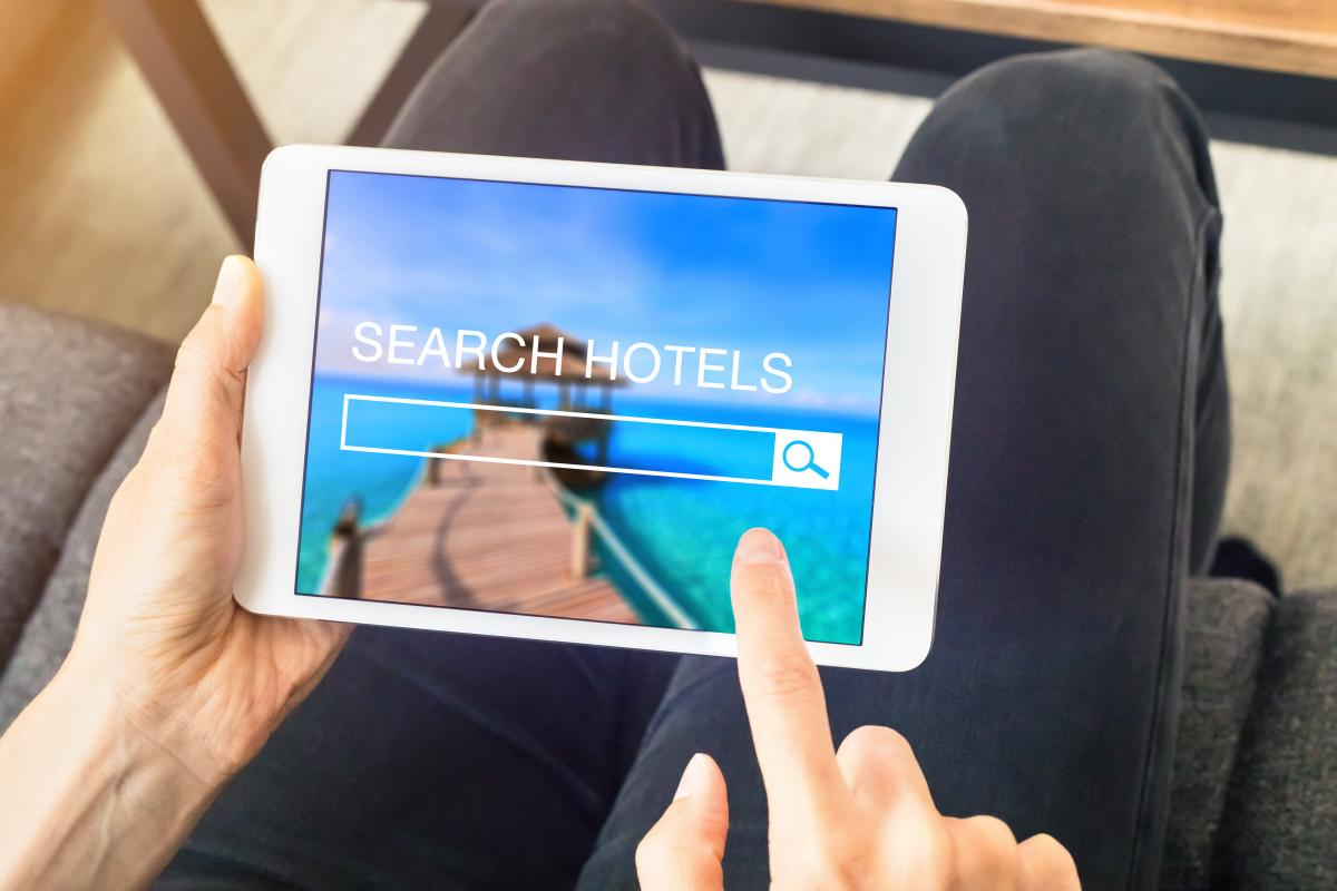 "an tablet with a ""search hotels"" screen"