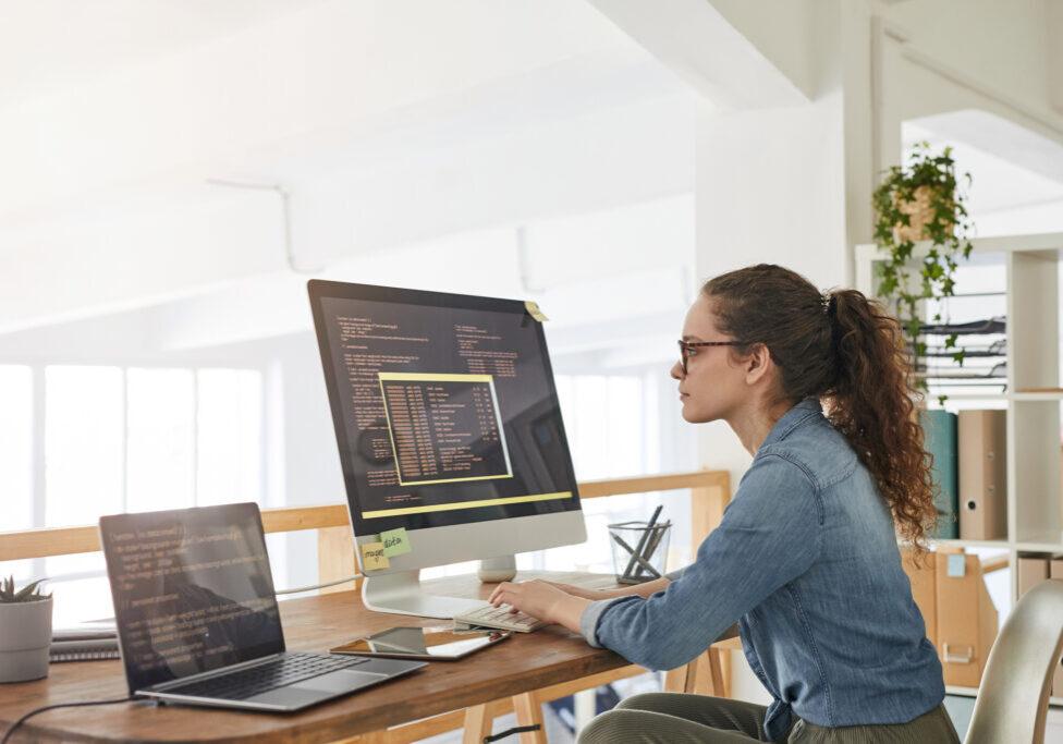 Young Woman Writing Software Code