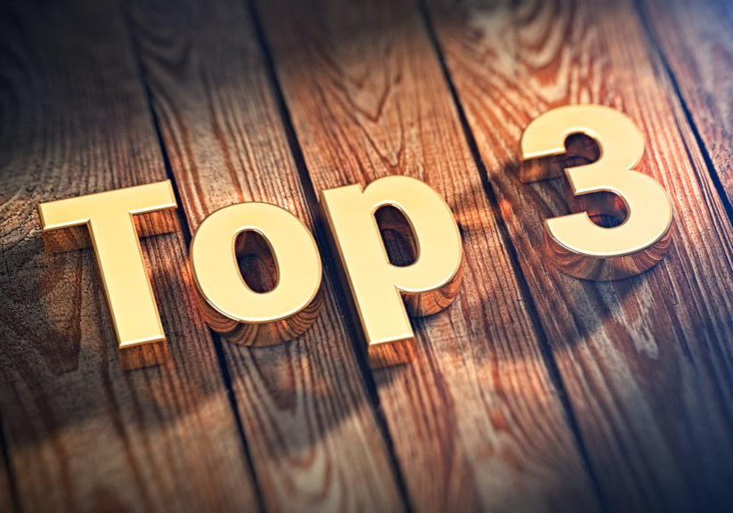 "Top three winners. On top of the list. The word ""Top 3"" is lined with gold letters on wooden planks. 3D illustration graphics"